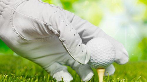 Bild Hand am Golfball